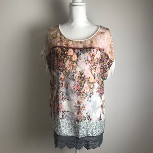 Unique floral top with lace on bottom